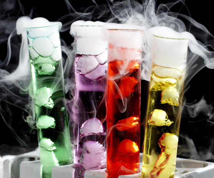 4 test tubes one red, one yellow, one green and one purple with dry ice inside.